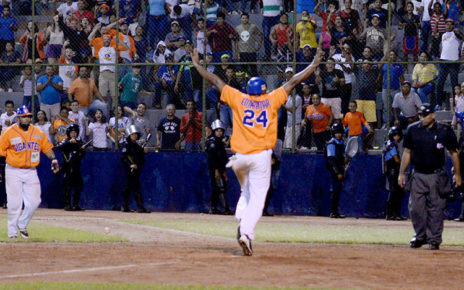 A player from Gigantes de Rivas celebrates scoring a run.