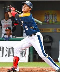 Wang Po-Jung watches a ball come off his bat in Taiwan.