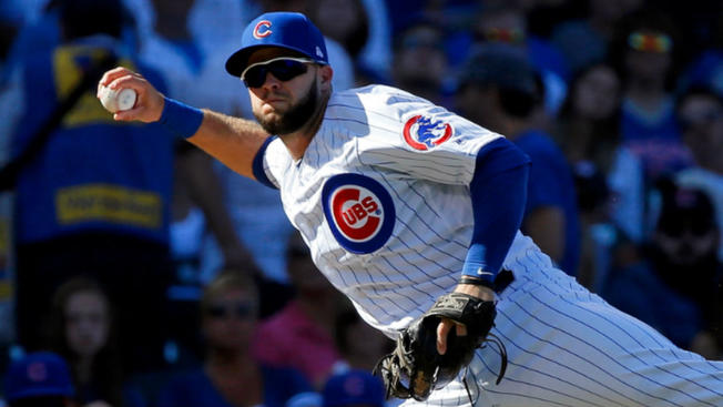 David Bote fielding a ball for the Chicago Cubs.