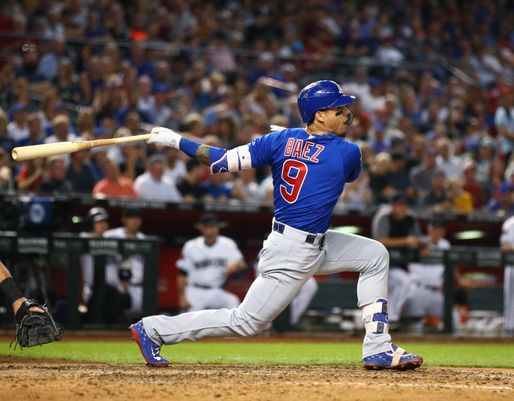 Javier Báez takes a big hack at the ball.