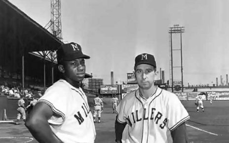 Willie Mays poses for a picture with the Minneapolis Millers.