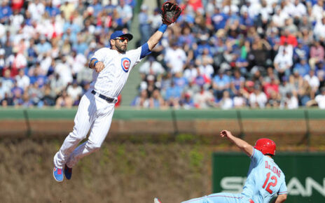 Daniel Descalso makes a leaping attempt at a ball.