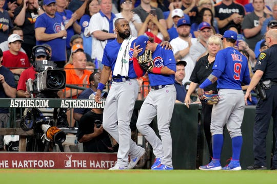 Albert Almora Jr. consoled by teammates after he struck a fan with a batted ball in Houston.