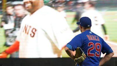 Brad Brach watches Pablo Sandoval celebrate a game winning home run.