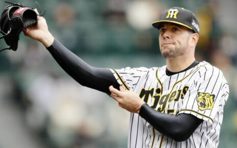 Randy Messenger adjusting his uniform.