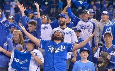 Kansas City Royals fans celebrating at Kauffman Stadium.