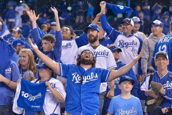 Kansas City Royals fans celebrating at Kauffman Stadium.