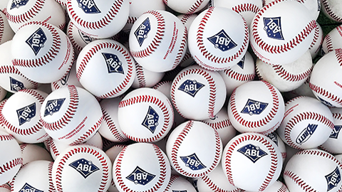 A collection of baseball with the ABL logo.