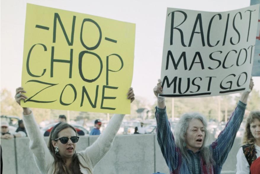 Fans protest outside of an Atlanta baseball game.