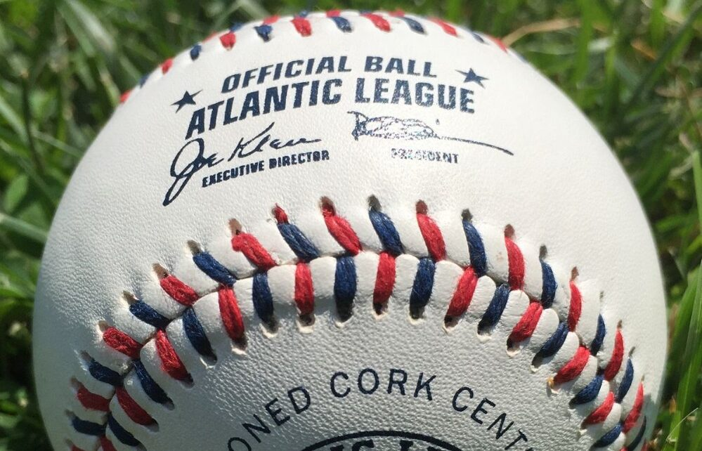 A red, shite, and blue laced baseball used by the Atlantic League