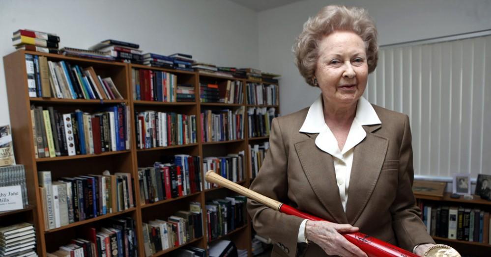 Dorothy Seymour Mills showing off some of her baseball memorabilia.