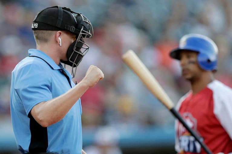 An umpire using a headset during the 2019 ALPB All-Star Game.