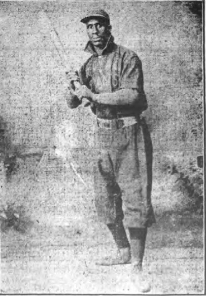 Home Run Johnson poses in his Brooklyn Royal Giants uniform