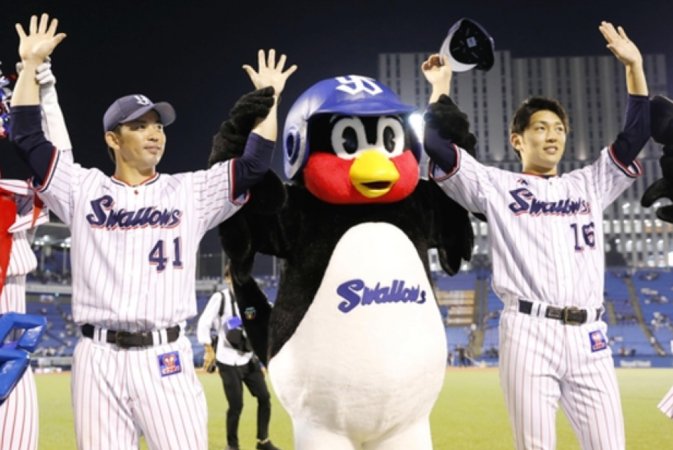 The Yakult Tokyo Swallows celebrate a victory