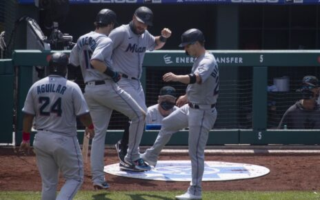 Miami Marlins players celebrating while having the Coronavirus