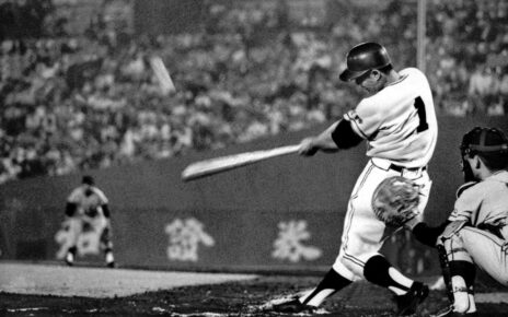 Sadaharu Oh likely about to launch a baseball very far.