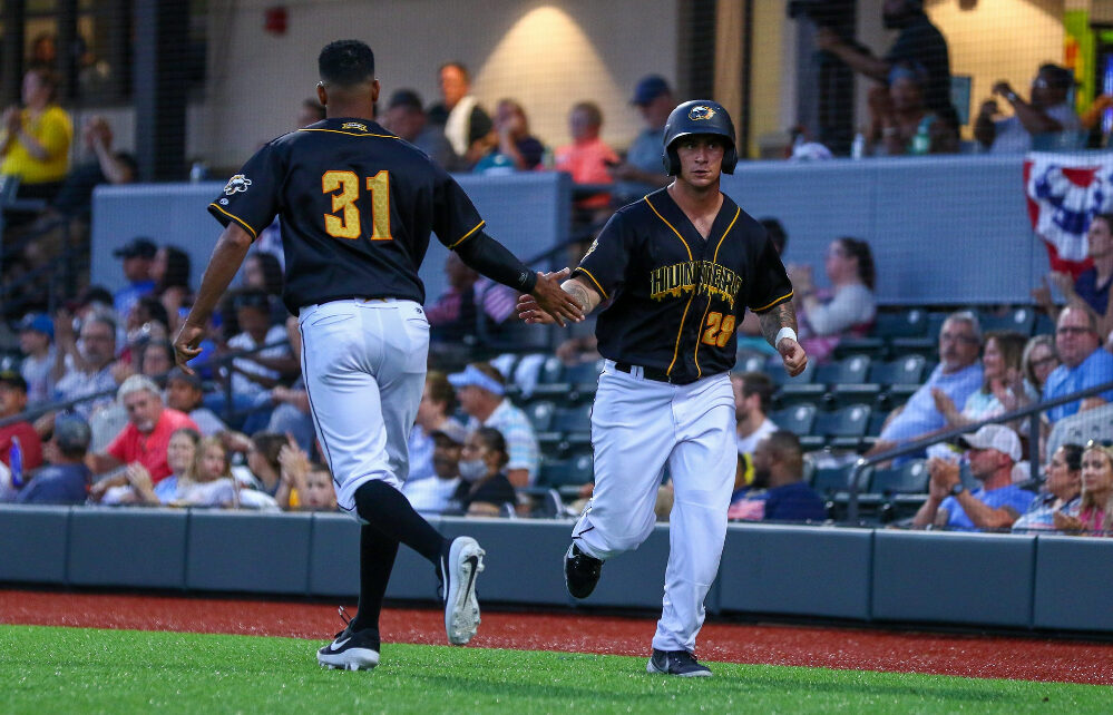 Josh Sale congratulated by a Honey Hunters teammate after doing something great.